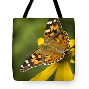 A Butterfly Sits Atop A Yellow Tote Bag