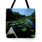 A Canoe Floats On A River Filled Tote Bag