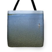 A Child Running Through The Water Tote Bag