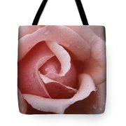 A Close View Of The Top Of A Pink Rose Tote Bag