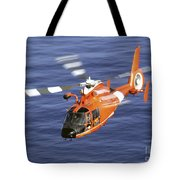 A Coast Guard Hh-65a Dolphin Rescue Tote Bag by Stocktrek Images