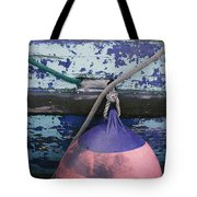 A Colorful Buoy Hangs From Ropes Tote Bag