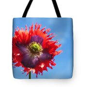 A Colorful Flower With Red And Purple Tote Bag