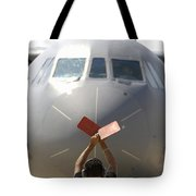 A Crew Chief Marshals In A C-141b Tote Bag