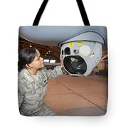 A Crew Chief Works On Mq-9 Reapers Tote Bag