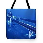 A Crewman Cranks Out The Dry Deck Tote Bag by Michael Wood