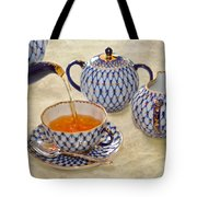 A Cup Of Tea Tea Being Poured Into A China Cup Tote Bag