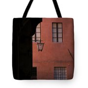 A Dark Alley Way Leads To A Lit Brick Tote Bag