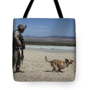 A Dog Handler Conducts Improvised Tote Bag by Stocktrek Images