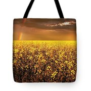 A Field Of Canola With A Rainbow Tote Bag