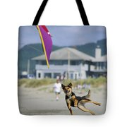 A German Shepherd Leaps For A Kite Tote Bag