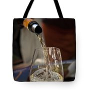 A Glass Of White Wine Being Poured Tote Bag