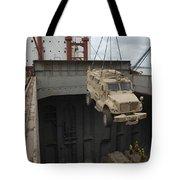 A Harbor Crane Lifts A Mine-resistant Tote Bag