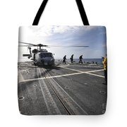 A Helicpter Sits On The Flight Deck Tote Bag