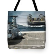 A Hovercraft Approaches Uss New Orleans Tote Bag
