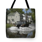 A Humvee Drives Through The Floodwaters Tote Bag