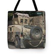 A Humvee Patrols The Streets Of Kunduz Tote Bag