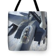 A Kc-135 Stratotanker Refuels An F-15e Tote Bag by Stocktrek Images