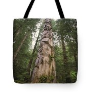 A Large Totem Pole Stands Amid Tall Tote Bag