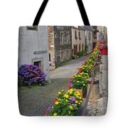 A Line Of Flowers In A French Village Tote Bag