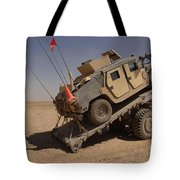 A M1114 Armored Vehicle Is Unloaded Tote Bag