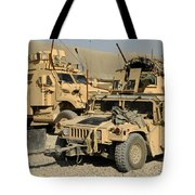 A M1114 Humvee Sits Parked In Front Tote Bag