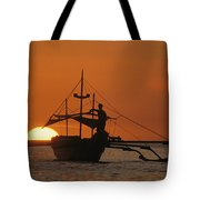 A Man And An Outrigger Silhouetted Tote Bag