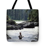 A Man Fishes For Cutthroat Trout In An Tote Bag