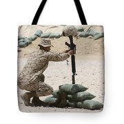 A Marine Hangs Dog Tags On The Rifle Tote Bag