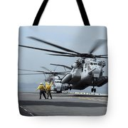A Marine Mh-53 Helicopter Takes Tote Bag