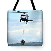 A Mh-60 Knighthawk Carries Supplies Tote Bag