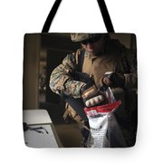 A Military Policeman Collects Materials Tote Bag