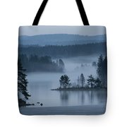 A Misty Forest Lake With A Small Island Tote Bag