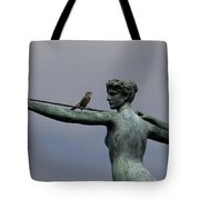 A Mockingbird Sits Atop A Bronze Tote Bag