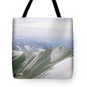 A Mountain Climber Hikes Tote Bag