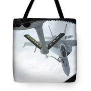A Navy Fa-18f Super Hornet Is Refueled Tote Bag by Stocktrek Images