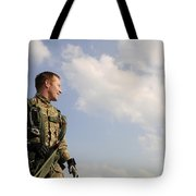 A Paratrooper Looks On As Other Tote Bag