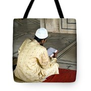 A Pious Devotee Reading The Quran Inside The Jama Masjid In Delhi Tote Bag