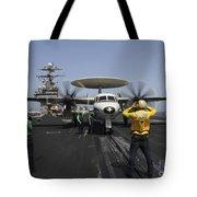 A Plane Director Guides An E-2c Hawkeye Tote Bag