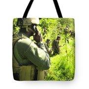 A Riverine Soldier Radios In Mock Tote Bag
