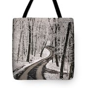 A Road Running Through Snow-covered Tote Bag
