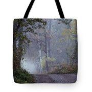 A Road Through A Misty Wood Tote Bag