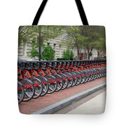 A Row Of Red Bikes Tote Bag