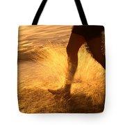A Runner Splashing Through The Surf Tote Bag