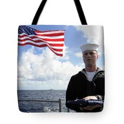 A Sailor Carries The National Ensign Tote Bag