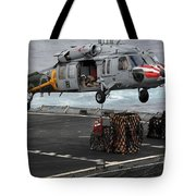 A Sailor Hooks Cargo To An Mh-60s Sea Tote Bag