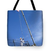 A Sailor Lowers The U.s. Navy Jack Tote Bag