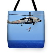 A Search And Rescue Swimmer Is Lowered Tote Bag