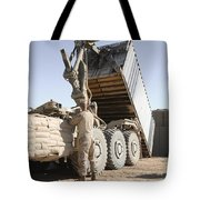 A Shipping Container Is Off-loaded Tote Bag