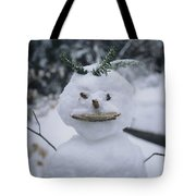 A Smiling Snowman With Twig Arms Tote Bag